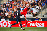 Danny Koevermans (14) of Toronto FC heads the ball. The Philadelphia Union defeated Toronto FC 3-0 during a Major League Soccer (MLS) match at PPL Park in Chester, PA, on July 8, 2012.