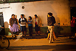 Women walk away from a crime scene where Guatemalan police, military, and firefighters investigate a shooting of four drug gangs dealers who were shot and killed, in Zone 10, in Mixco, Guatemala, on Saturday, Nov. 5, 2011. Mixco is a transit point for drug traffickers, including the ruthless Los Zetas Mexican drug cartel. In the past three years, Guatemala has seen a rise in Mexico drug gangs because of the major anti-drug operations launched by Mexican President Felipe Calderon, and because of its porous borders, drug gangs can easily transit drugs from Colombia through Mexico.