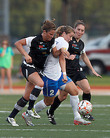 Boston Breakers forward Katie Schoepfer (2) attempts to control the ball as New England Mutiny defender Kelsey Hood (22) and New England Mutiny midfielder Jenny Maurer (27) defend. In a Women's Premier Soccer League Elite (WPSL) match, the Boston Breakers defeated New England Mutiny, 4-2, at Dilboy Stadium on June 20, 2012.