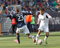 Vancouver Whitecaps FC defender Steven Beitashour (33) dribbles. In a Major League Soccer (MLS) match, the New England Revolution (blue/white) tied Vancouver Whitecaps FC (white), 0-0, at Gillette Stadium on March 22, 2014.