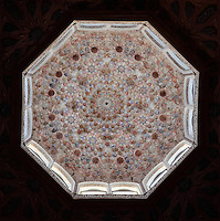 Ceiling of the dome covered in stucco lacework in the Madrasa of Granada, a mosque school founded 1349 by the Nasrid King Yusuf I, Sultan of Granada, in El Albayzin, the medieval Moorish old town of Granada, Andalusia, Southern Spain. The madrasa functioned as a university until 1499 and is now part of the University of Granada. From the 8th to the 15th centuries, Granada was under muslim rule and retains a distinctive Moorish heritage. Granada was listed as a UNESCO World Heritage Site in 1984. Picture by Manuel Cohen
