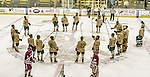 25 November 2014: The University of Vermont Catamounts salut the fans after the game against the University of Massachusetts Minutemen at Gutterson Fieldhouse in Burlington, Vermont. The Cats defeated the Minutemen 3-1 to sweep the 2-game, home-and-away Hockey East Series. The 12th ranked Catamounts wore their camouflage uniforms for the evening to honor the US military. Mandatory Credit: Ed Wolfstein Photo *** RAW (NEF) Image File Available ***