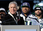 As Seattle Seahawks linebacker Bobby Wagner smiles as head coach Pete Carroll talks to fans during the Super Bowl XLVIII celebration at  CenturyLink Field on February 5, 2014 in Seattle.