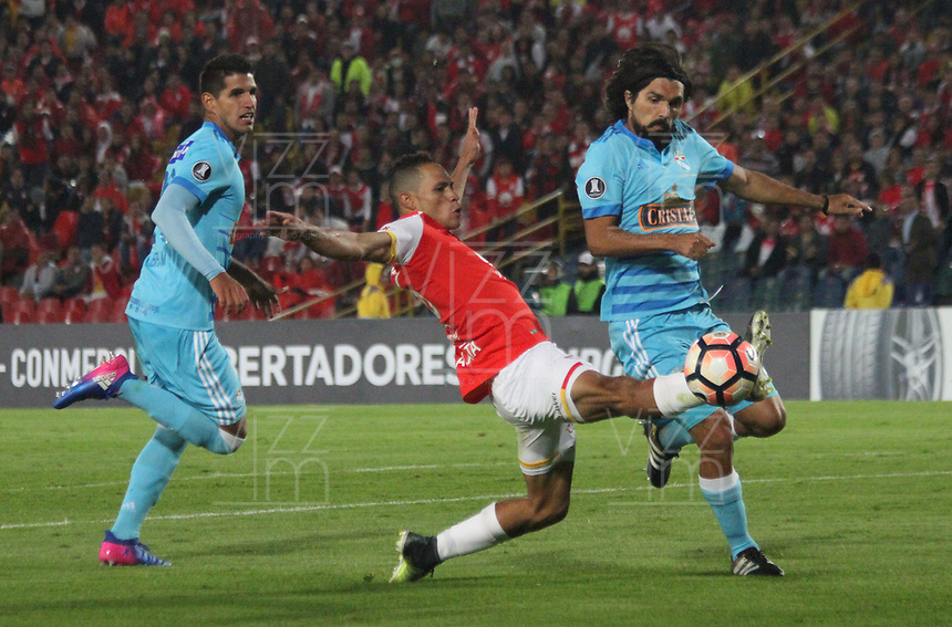 BOGOTA -COLOMBIA, 4-03-2017.    Anderson Plata (L)player of  Independiente Santa Fe of Colombia fights the ball agaisnt Jorge Cazulo (R) player of  Sporting Cristal of Peru during match for the date 2   for the Conmebol Libertadores Bridgestone Cup 2017 played at Nemesio Camacho El Campin stadium . Photo:VizzorImage / Felipe Caicedo  / Staff