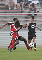 BOYDS, MARYLAND - July 21, 2012:  Lianne Sanderson (10) of DC United Women goes for the ball aginst Samantha Hare (22) of the Virginia Beach Piranhas during a W League Eastern Conference Championship semi final match at Maryland Soccerplex, in Boyds, Maryland on July 21. DC United Women won 3-0.