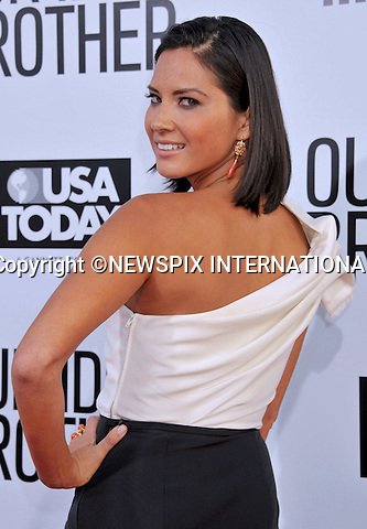 """OLIVIA MUNN.attend the Premiere of """"Our Idiot Brother"""" at Arclight Hollywood Theatre, Los Angeles_16/08/2011.Mandatory Photo Credit: ©Crosby/Newspix International. .**ALL FEES PAYABLE TO: """"NEWSPIX INTERNATIONAL""""**..PHOTO CREDIT MANDATORY!!: NEWSPIX INTERNATIONAL(Failure to credit will incur a surcharge of 100% of reproduction fees).IMMEDIATE CONFIRMATION OF USAGE REQUIRED:.Newspix International, 31 Chinnery Hill, Bishop's Stortford, ENGLAND CM23 3PS.Tel:+441279 324672  ; Fax: +441279656877.Mobile:  0777568 1153.e-mail: info@newspixinternational.co.uk"""