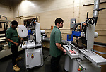 Waterbury, CT- 20 April 2017-042017CM02- Career Academy seniors, Jasyah Allen, left, and Brenden Fernandes work at machines at Cly-Del during an internship in Waterbury on Thursday.    Christopher Massa Republican-American