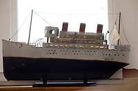 model of a ship sitting on a window sill