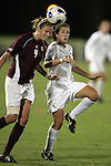 7 November 2007: Boston College's Caroline Walden (4) heads the ball away from Florida State's Amanda DaCosta (right). Florida State University defeated Boston College 1-0 at the Disney Wide World of Sports complex in Orlando, FL in an Atlantic Coast Conference tournament quarterfinal match.