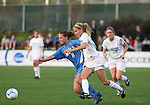 1 December 2006: UCLA's Lauren Cheney (8) is defended by North Carolina's Kristi Eveland (32). The University of North Carolina Tarheels defeated the University of California Los Angeles Bruins 2-0 at SAS Stadium in Cary, North Carolina in an NCAA Division I Women's College Cup semifinal game.