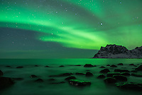 Aurora Borealis - Northern Lights over sea at Utakleiv, Vestvågøy, Lofoten Islands, Norway