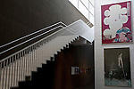 Photo shows a staircase next to an exhibition of works by Shuji Terayama at the Aomori Museum of Art in Aomori City, Aomori Prefecture, Japan on 11 July, 2001. The building was designed by Jun Aoki, the inspiration coming from the nearby Sannai Maruyama archeological site. .Photographer: Robert Gilhooly