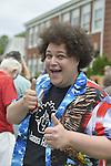 Wantagh, New York, USA. July 4, 2015. ADAM EZEGELIAN, American Idol Season 14 finalist and Wantagh resident, gives a smiling two thumbs up gesture after singing  at start of The Miss Wantagh Pageant ceremony, a long-time Independence Day tradition on Long Island, which is held at Wantagh School after the town's July 4th Parade.