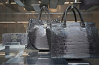 Handbags are featured in the window of the Michael Kors store on Fifth Avenue in New York on Wednesday, July 31, 2013. Brands such as Michael Kors, Tory Burch and Kate Spade are cutting into Coach's sales of leather goods in the luxury market. (© Richard B. Levine)