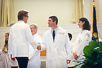From left, Andrew Tranmer, Dean Rick Morin, M.D., Stephen Leffler, M.D., Ursula McVeigh, M.D. Class of 2017 White Coat Ceremony.