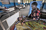 A mother cares for her sick child in the United Methodist Hospital in the village of Wembo Nyama, DR Congo.