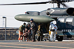 An elderly woman is helped off a Japan Self Defense Force helicopter after being evacuated from her home to the Red Cross hospital in Ishinomaki,  Miyagi Prefecture, Japan on  13 March 20011..Photographer: Robert Gilhooly