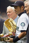 Seattle Mariners right fielder Ichiro Suzuki, of Japan, holds his 9th Golden Glove Award he received during opening ceremonies before the opening home game of the season with the Oakland Athletics at SAFECO Field in Seattle April 12, 2010.  During pregame ceremonies, Suzuki received his 9th consecutive Golden Glove and his  third Silver Slugger Awards. The Mariners open a three-game homestand against the Oakland Athletics.