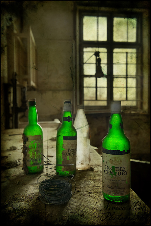 Green bottles in an the kitchen of an abandoned house http://www.vivecakohphotography.co.uk/2011/09/09/double-century/