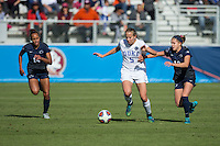 Cary, North Carolina - Sunday December 6, 2015: Rebecca Quinn (5) of the Duke Blue Devils works to keep the ball away from Charlotte Williams (12) and Ellie Jean (14) of the Penn State Nittany Lions during first half action at the 2015 NCAA Women's College Cup at WakeMed Soccer Park.  The Nittany Lions defeated the Blue Devils 1-0.