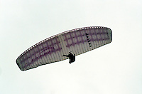 AIR SPORTS<br /> Paraglider In Flight<br /> A foot launched, aerofoil canopy made of Dacron, designed to be flown and landed with no other energy requirements than wind gravity and pilot's muscle power.