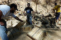 Tripoli, Libya, August 25, 2011.Rebel fighters unearth large quantities of ammunitions hidden by Khaddafi supporters from the park located between the Bab Aziziya compound and the Rixos hotel.