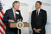 United States President Barak Obama is introduced by Boeing CEO James McNerney Jr. prior to remarks to members of the Business Roundtable to discuss jobs and economic growth during a forum at the Newseum in Washington, DC USA 06 March 2012. Economists see slightly stronger growth and hiring than they did two months ago, trends that would help President Barack Obama's re-election hopes..Credit: Shawn Thew / Pool via CNP