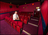 BNPS.co.uk (01202 558833)<br /> Pic: PhilYeomans/BNPS<br /> <br /> Stunning interior recreates the ABC cinema's from the 1980's.<br /> <br /> Field of Dreams....<br /> <br /> Film buff Andy Jones has built an ABC cinema in his back garden as a lasting tribute to the now defunct movie company.<br /> <br /> Andy, 38, has taken four and a half years and spent &pound;70,000 of his life savings building the 34-seat cinema from scratch.<br /> <br /> The father-of-two's movie house mirrors cinemas of the 1930s with big red curtains, red seats and a parquet floor in the projection room. <br /> <br /> The brick building, which is adorned with an ABC sign, is 40ft tall, 22ft wide and 20ft high and takes up half of the garden of his three bed semi-detached house.<br /> <br /> The theatre, which has a 17ft by 7ft screen, has its own projection room, black and white old-style toilets and a foyer with a concessions stand that offers popcorn and sweets.