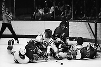 California Golden Seals vs New York Islanders, net action Seals, Mike Christie, #10 Charlie Simmer, #6 Len Frig, and goalie Gary Simmons, Islanders #9Clark Gilles, and #15Billy Harris.  (1975 Photo/Ron Riesterer)