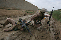 Iraq: Karmah: October 31, 2006: Sgt Jesse E. Leach drags Lance CPL Juan Valdez of the 4th mobile assault platoon Weapons company 2nd battalion 8th Marines to safety moments after he was shot by a sniper during a joined patrol with the Iraqi Army in Karmah, Anbar Province, Iraq. Valdez was shot through the arm and the right side but survived.