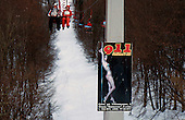 A poster advertising a strip club hangs on a ski chairlift structure in Russia's Black Sea coastal city of Sochi. .The resort, perched on the foot of snow-capped mountains, is bidding to host the 2014 Winter Olympics.
