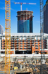 The Austonian under construction in Austin Texas, February 15, 2009.  The Austonian is a residential skyscraper currently under construction in Austin. Upon completion in 2009, the building will be the tallest in Austin at 683 feet tall with 56 floors.  This photo shows the Austonion through the site of the W Tower and the Amli apartment building in downtown Austin.
