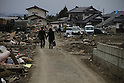 The city of Natori became famous as the live broadcast of the tsunami tearing through it was seen around the world.  A month and a half later, rebuilding is still a distant thought.  Families struggle to sort through their heavily damaged homes.  The Miuras walk through the wreckage, away from their ruined home in the Nakazuka neighborhood..