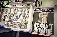 Front pages of the NY Post and NY Daily News have divergent views on Thursday, December 4, 2014 reporting on the previous days Grand Jury not indicting NYPD Officer Daniel Pantaleo in the death of Eric Garner and the subsequent protests.    (© Richard B. Levine)