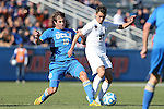 14 December 2014: UCLA's Leo Stolz (GER) (10) trips Virginia's Jake Rozhansky (17). The University of Virginia Cavaliers played the University of California Los Angeles Bruins at WakeMed Stadium in Cary, North Carolina in the 2014 NCAA Division I Men's College Cup championship match.