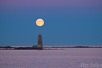 The September 'Harvest Moon' rises over Whaleback Lighthouse in Portsmouth Harbor