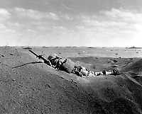 This Marine, member of the &quot;Fighting Fourth Marine Division,&quot; threatens the enemy even in death.  His bayonet fixed at the Charge, he was killed by intense Japanese sniper fire as he advanced.  February 19, 1945.  Sgt. Bob Cooke.  (Marine Corps)<br /> NARA FILE #:  127-N-109624<br /> WAR &amp; CONFLICT BOOK #:  1223