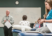 NWA Democrat-Gazette/ANTHONY REYES &bull; @NWATONYR<br /> Dr. David Taylor, Associate Professor of Physical Therapy at University of Arkansas for Medical Sciences, reviews some course material and testing procedures Thursday, Dec. 10, 2015 at the school in Fayetteville. The students were in a lab reviewing course material for their upcoming final exams. The school is finishing its first semester in Fayetteville.