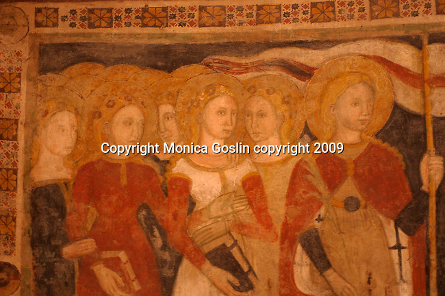 Looking at the frescoes in the Baptistery in Parma, Italy; the Baptistery is an octagonal shape, covered inside with 13th and 14th century paintings and frescoes