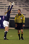 2 November 2005: North Carolina goalkeeper Aly Winget (left) complains to referee Renzo Gentile (right) about interference in the penalty area during Maryland's 69th minute goal. The University of North Carolina defeated the University of Maryland 3-1 at SAS Stadium in Cary, North Carolina in the quarterfinals of the 2005 ACC Women's Soccer Championship.
