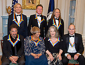 The five recipients of the 39th Annual Kennedy Center Honors pose for a group photo following a dinner hosted by United States Secretary of State John F. Kerry in their honor at the U.S. Department of State in Washington, D.C. on Saturday, December 3, 2016.  From left to right back row: Joe Walsh, Don Henley, and Timothy B. Schmidt of the rock band &quot;The Eagles.&quot; Front row, left to right: Al Pacino, Mavis Staples, Martha Argerich, and James Taylor.  The 2016 honorees are: Argentine pianist Martha Argerich; rock band the Eagles; screen and stage actor Al Pacino; gospel and blues singer Mavis Staples; and musician James Taylor.  From left to right back row: Joe Walsh, Don Henley, and Timothy B. Schmidt of the rock band &quot;The Eagles.&quot; Front row, left to right: Al Pacino, Mavis Staples, Martha Argerich, and James Taylor.<br /> Credit: Ron Sachs / Pool via CNP