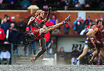 North Adelaide footballer Andrew McIntyre makes a kick out of a muddy centre square during a South Australian National Football League match against Central Districts.<br />