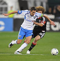 Impact midfielder Davy Arnaud (22) shields the ball against D.C. United midfielder Nick DeLeon (18) D.C. United tied The Montreal Impact 1-1, at RFK Stadium, Wednesday April 18 , 2012.