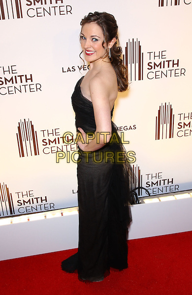 Laura Osnes.Grand opening of The Smith Center for the Performing Arts, Las Vegas, Las Vegas, Nevada, USA, .10th March 2012..full length strapless black dress hand on hip long maxi  side back rear over shoulder .CAP/ADM/MJT.© MJT/AdMedia/Capital Pictures.