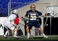 Reid Acton (14) of Loyola forces the ball out of the stick of Nicholas Beattie (38) of Notre Dame during the Face-Off Classic in at M&T Stadium in Baltimore, MD
