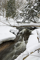 The fast-moving Carp River flowing through freshly fallen snow. Marquette, MI