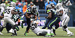 Seattle Seahawks running back Marshawn Lynch (24) rushes against the Oakland Raiders at CenturyLink Field in Seattle, Washington on November 2, 2014.  Lynch rushed for 67 yards, caught five passes for 76 yards and scored two touchdown as the Seahawks beat the Raiders 30-24. ©2014. Jim Bryant Photo. All rights Reserved.
