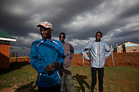 Kenyan athletes (L-R) Elias Maindi, Johanna Kariankei and Joseph Langat, train in the hills close to Iten town, the country's running capital. The global recession has robbed races and runners of sponsorship, cutting their chances of earning a living from running