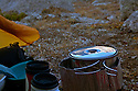 WY01344-00...WYOMING - Cirque of Towers reflecting on the lid of a cook pot a camp near Big Sandy/Jackass Pass in the Popo Agie Wilderness section of the Wind River Range.