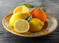 Fresh whole oranges and lemons